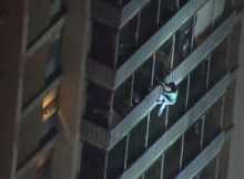 Man scales 19-story apartment building during smoky fire in search of his mother