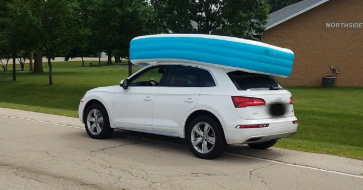 Mom had young daughters ride in inflatable pool on top of car 'to hold it down'