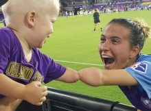 Viral photo captures precious bond between soccer star and one-year-old fan