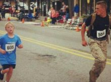 Marine sees 9-year-old struggling in marathon, slows down and holds his hand to help him finish
