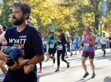Dad carries newborn son with Down syndrome over Marathon finish line – let's hear it for them
