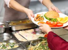 School district apologizes after staff throws out students' lunches over $15 debt