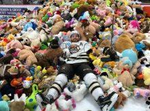 Hockey fans flood ice with 45,650 stuffed animals for annual teddy bear toss