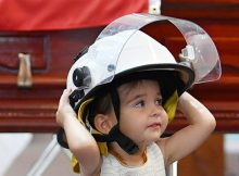 20-month-old wears Australian firefighter dad's helmet and refuses to leave his side at funeral