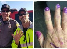 Firefighters calm down scared little girl at crash scene by asking her to paint their nails
