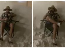 Chill Canadian guy cracks open a beer in the middle of massive blizzard