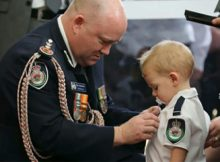 Toddler accepts bravery award on behalf of his firefighter dad killed in bushfires